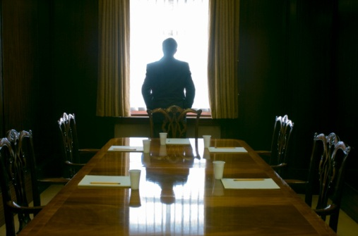 lonely at the top - man in boardroom