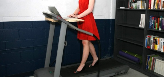 productivity multitasking woman working on treadmill