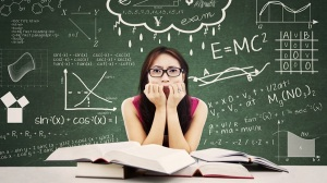 woman in front of math board