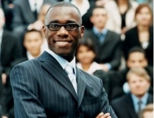 black man smiling in front of group