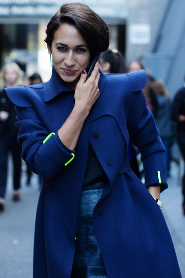 woman on the go - phone in blue